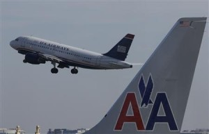 US Airways and American Merger Waiting...just like passengers.